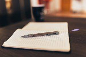 pen and notepad for personal statement writing