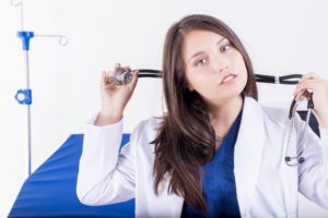 OB/GYN physician putting on stethoscope
