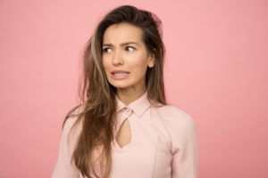 single woman wearing pink against pink background