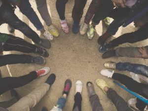 group putting their feet into a circle