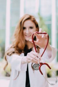 med student with white coat and stethescope
