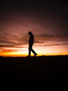 Sunset Image - man with head down